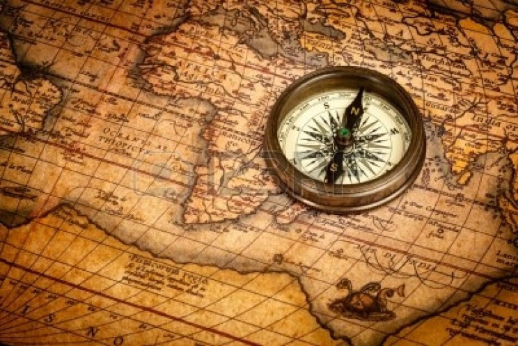 13993072-old-vintage-retro-compass-on-ancient-map1